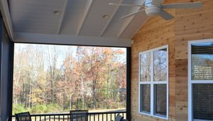 Narrow skylights add natural daylighting to the screened porch while ENERGY STAR ceiling fans provide cooling air flow.