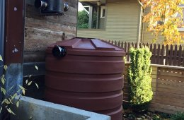 Rainwater is collected with a harvesting system that includes a 420-gallon cistern storage tank. The rainwater is twice filtered and used in toilets and hose bibs.
