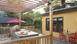 <p>The new outdoor space is outfitted with a fully functioning outdoor kitchen, including a grill, sink and dining area. The trellis provides shade during hot summer days and heaters keep guests warm on cool nights. A nearby play area and garden provides entertainment and enjoyment for kids and parents alike.</p>  <p>The decking material is durable ipe wood and the handrails and trellis are cedar. The new windows and doors maximize the connection between the indoors and outdoors.</p>