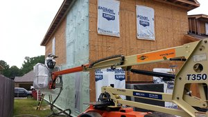 The builder installed 1.5 inches of soy-based spray foam on the outside of the walls over the OSB sheathing, then he kept a ¾-inch gap between the foam and the brick veneer siding to allow moisture vapor from the bricks to dissipate.