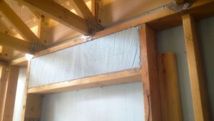 Headers over windows and doors are constructed to leave space for insulation.