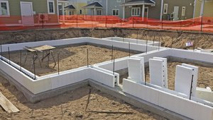 After pouring the footings, insulated concrete form (ICF) blocks were stacked 36 inches high and filled with concrete to form sturdy insulated foundation walls.