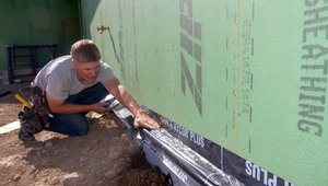 Special tape provides air-sealing and flashing at the intersection of the foundation and the wall.