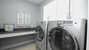 The ENERGY STAR-rated washing machine, dishwasher, and refrigerator save water and energy.