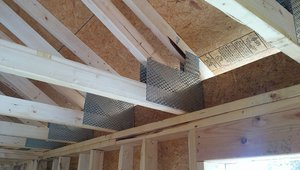 Raised-heel trusses increase the roof height at the exterior walls so, after the ceiling drywall is installed, there will be more room for insulation over the eaves.