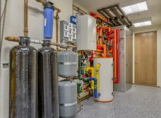 In addition to solar water heating, the home is equipped with a fan coil supplied by an air-to-water heat pump and a ducted mini-split heat pump that provides backup heating and cooling. A heat pump water heater provides additional backup hot water.