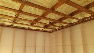 Eight inches of closed-cell spray foam covered the underside of the roof deck to create an insulated nonvented attic.
