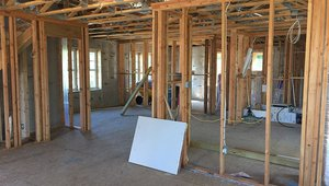 Sealed and insulated ducts run through the floor trusses to keep ducts inside conditioned space.