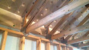 Raised-heel roof trusses allow more room at the eaves for attic insulation.