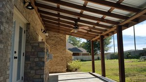 Overhangs and covered porches help to control solar heat gain in this warm-humid climate.