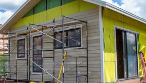 Fiber cement board siding provides a durable finish over the taped coated OSB water barrier and mesh spacer.