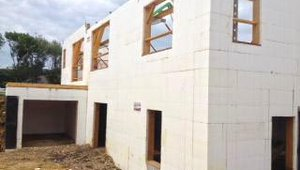 Most of the home's exterior walls were constructed with insulated concrete forms. ICFs combine foam insulation with steel-reinforced concrete for durable and well-insulated walls.  ICFs form a tightly air-sealed, highly insulated structure for this home, contributing to energy cost savings of over $4,000 per year compared to a similar-sized home built to code.