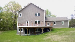 A daylight basement and insulated attic mean three floors of living space plus storage in the compact structure.