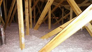 The vented attic is insulated with a thick blanket of R-38 blown-in fiberglass insulation.