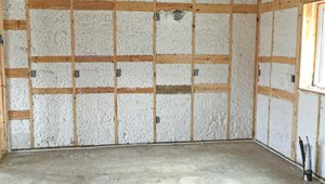Blown-in fiberglass insulation fills the cavities of the wall to help provide a continuous thermal blanket.