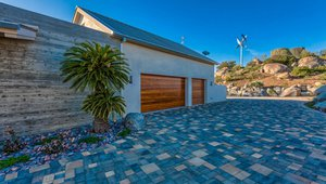 Stone, gravel, and pavers provide a pervious, fire-resistant ground cover around the home while xeriscaping keeps irrigation needs at a minimum. Behind the home's three-coat stucco siding, a liquid-applied membrane provides a weather-resistant barrier and rain screen.