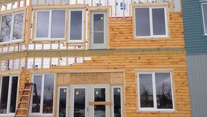 Furring strips were installed over the sealed rigid foam insulation to create a ventilating gap and drainage plane beneath the fiber cement, metal, and wood siding.