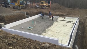 The basement slab is wrapped in a blanket of insulation including R-27 of closed-cell spray foam under the slab and R-22 ICF blocks wrapping the slab edges.