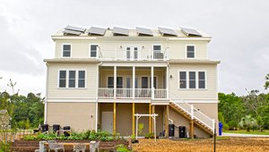 The 6.8 kilowatts of solar photovoltaic panels on the roof contribute $1,200 to the annual energy cost savings of $2,350 this high-performance home is expected to achieve compared to a home built to the 2012 International Energy Conservation Code. Solar panels are installed at the optimal angle for gathering light at this location. They have already survived a tornado without damage. The home also has two solar water heating panels.
