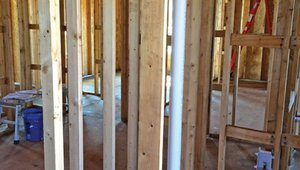 Energy-efficient advanced framing details including insulated corners, insulated headers, and ladder blocking for interior wall intersections create more space for wall insulation and reduce lumber costs.