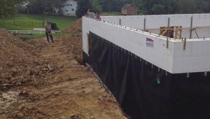 Insulated concrete forms (ICF) have insulation built right into them and help to form a continuous thermal blanket around the building.  A water-resistant barrier helps to protect basement walls.