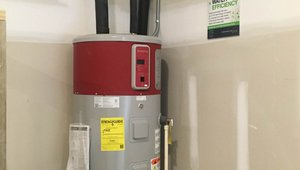 A high-efficiency 50-gallon heat pump water heater provides hot water for the entire home.