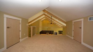 The vaulted ceilings are insulated with 2 inches of closed–cell spray foam plus blown cellulose for a thick blanket of thermal protection to help keep this loft space warm in the winter and cool in the summer.