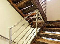 The floors, stairs, and treads were built out of 100-year-old hand-hewn mixed hardwoods from Montana.
