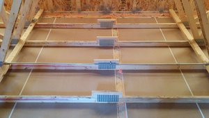 This view from the attic side of the ceiling shows how every seam in the drywall and between the dry wall and the 2-by-4 top-plates is carefully caulked to stop air leaks.