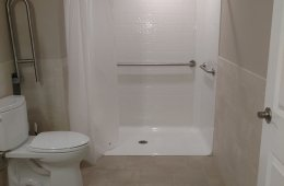 The handicapped-accessible bathroom saves water with WaterSense-qualifying fixtures.