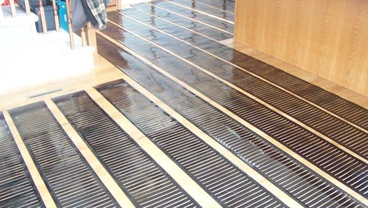 Is Gas Or Electric Right For Your Underfloor Radiant Heating - Under floorboard heating