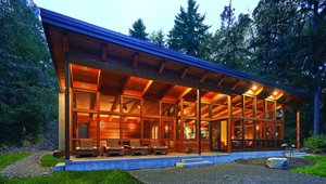Vashon Island House, Vashon Island, Washington, This 1,750 sq. ft home used timber framing and SIPs to achieve a tight building envelope. The house is heated with a radiant floor heating system that uses an electric, powered by the abundant wind energy in the region. With natural ventilation and breezes off Puget Sound, the house requires no air-conditioning. Photo by Dale Lang