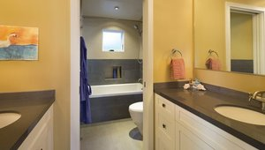 <p>Upstairs, the Jack and Jill bathrooom with&nbsp;dual vanities and enclosed toilet room allow both kids to get ready at the same time.</p>