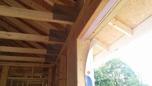 """Builders sometimes """"over-engineer"""" and use solid wood for the headers above doors and windows. BrightLeaf ran the calculations to determine how much wood was really needed to carry the roof load and filled the rest of the space with rigid foam for insulated headers."""