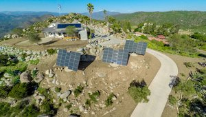 In a quest for energy and water self-sufficiency, the homeowners installed 22 kW of sun-tracking photovoltaic panels, a 3.2-kW wind mill, batteries for power storage, a solar thermal water heating system, and nine 10,000-gallon tanks as part of a water collection and recycling system that meets all of the home's domestic water, irrigation, and fire suppression needs.