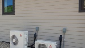 Two high-efficiency (12 HSPF, 26 SEER) ductless mini-split heat pumps heat and cool the home.