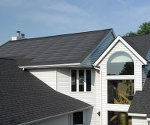 Integrated solar roofing combines panels and shingles (video)