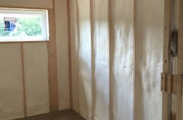 The 2-by-6, 24-inch on-center walls of the home are filled with R-21 closed-cell spray foam then wrapped with 7⁄16-inch plywood and topped with R-5.5 rigid foam for a continuous layer of thermal protection. House wrap provides an air barrier and drainage plane under the engineered wood siding.