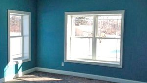 The home's double-pane windows have low-emissivity coatings to limit heat transmission and an argon gas fill between the panes that improves their insulating abilities.  Ceiling fans circulate air and can help reduce the need for air conditioning.