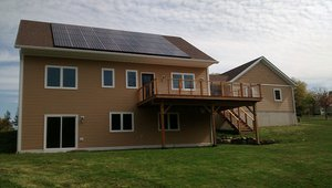 A 9.9-kW photovoltaic electric generation system contributes about $1,600 a year in energy savings.