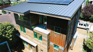 Durable standing-seam metal roofing covers the shed roof, which has very few penetrations to minimize heat loss and maximize the space available for solar photovoltaic panels. Dwell installed 8.1 kW of PV, which will help cut energy costs to $51 per year.