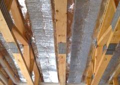 Reflective insulation is placed below hot water pipes in the floor as part of the radiant heating system.  Tubing will circulate hot water under the flooring to provide radiant floor heat. The water is heated by an ultra-efficient geothermal heat pump.