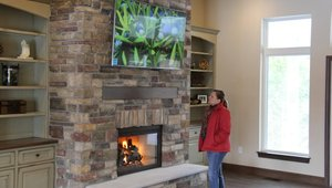 <p>Gracing the Great Room over the fireplace &ndash; clad in cultured stone from Boral Brick &ndash;is LG&rsquo;s dramatic new 79-inch class (78.5-inches diagonal) 4K Ultra HD TV, with four times the resolution of conventional 1080p Full HD.</p>  <p>Despite is mammoth size, ultra high resolution and webOS Smart TV capabilities, this TV costs only $27 per year in electricity to operate (while the annual electricity cost of similar models in this size ranges from $39 to $90 per year), according to its Federal Trade Commission EnergyGuide label.</p>