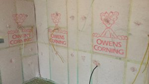 The home has Owens Corning blown fiberglass insulation in all its interior walls, and achieved an R-value in the walls is >22, and in the ceiling the R-value is 49.