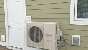 A high-efficiency ductless heat pump provides heating and cooling for the house with a heating efficiency of 9.3 HSPF and a cooling efficiency of 18 SEER. (The federal minimum is 7.7 HSPF and 13 SEER.)
