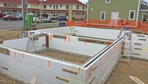 Insulated concrete forms combine rigid foam insulation panels with a steel-reinforced poured concrete core to provide a durable and efficient foundation wall that is part of a continuous thermal blanket.