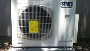A high-efficiency ductless heat pump provides both heating and cooling. The heat pump has a Heating Season Performance Factor (HPSF) of 9.1 and a cooling efficiency Seasonal Energy Efficiency Ratio (SEER) of 20.