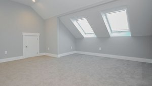 The conditioned, partially finished attic in this home is insulated with 8 inches (R-28) of open-cell polyurethane spray foam that helps keep the space warm in the winter and cool in the summer.