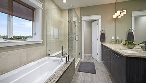 This home is equipped with water-saving, EPA WaterSense-rated fixtures and a hot water recirculation loop to speed hot water to the tap from the tankless gas water heater.