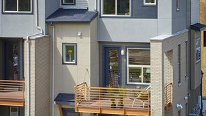 Balconies provide outdoor space and shade entry areas to help cool air for ventilation.